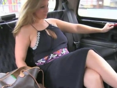 Natural busty blonde milf gives a blowjob in a taxi