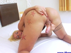 Solo blonde tranny plays with her hardened cock