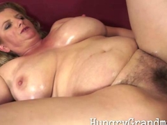 Busty chubby grandma playing with her dick