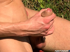 Watch Alexi slowly work up to popping his huge load outside